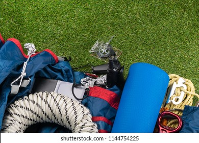 equipment traveler on the mountains and forests lies on the green grass