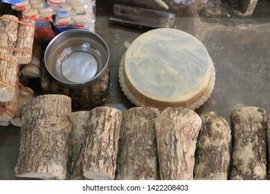 Equipment used to scrape the Tanaka tree for applying sunscreen.