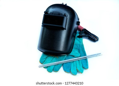 Equipment of welding, welding head shield, leather gloves, welding electrodes,and electrodes holder on white background