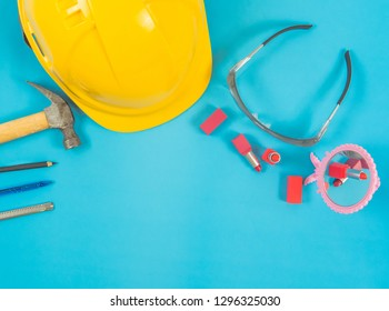 Equipment of women engineers placed on the desk and with cosmetics.