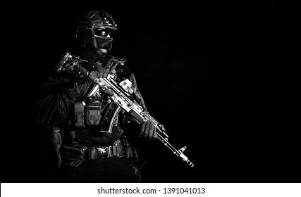 Equipped elite forces soldier low key portrait