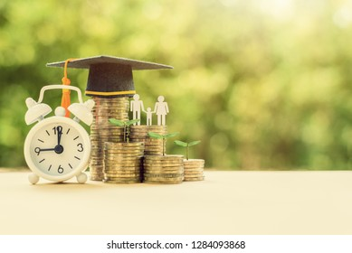 Equitable / global education fund concept : Black graduation cap on coins with white clock, green sprout, family members, depicts investment trust, savings for child knowledge, graduate study program