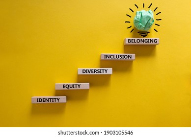 Equity, idenyity, diversity, inclusion, belonging symbol. Wooden blocks with words identity, equity, diversity, inclusion, belonging on beautiful orange background. Inclusion, belonging concept.