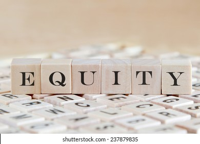 equity word background on wood blocks