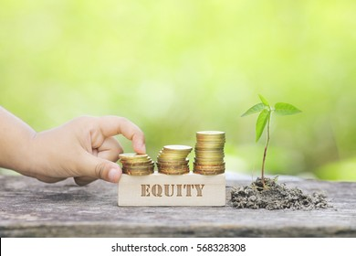 EQUITY WORD Golden coin stacked with wooden bar