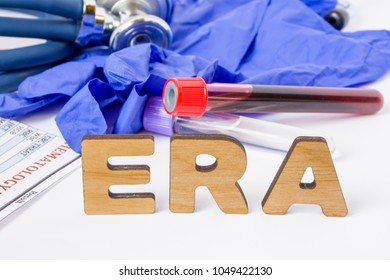ERA Clinical laboratory medical acronym or abbreviation of estrogen receptor assay or test to find out if cancer cells have this receptor. Word ERA are near laboratory test tubes with blood sample