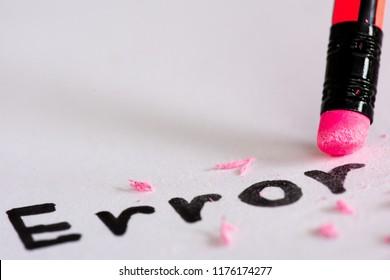 """Erase the word Error with a rubber concept of eliminating the error, mistake. closeup of a pencil erasing an """"error""""."""