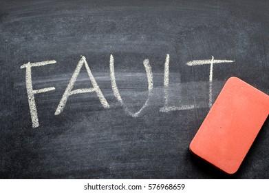 erasing fault, hand written word on blackboard being erased concept