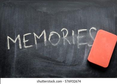 erasing memories, hand written word on blackboard being erased concept