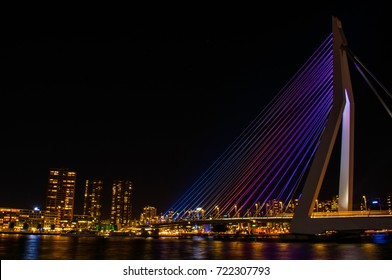 Erasmus bridge during the night colored in rainbow colors in Rotterdam