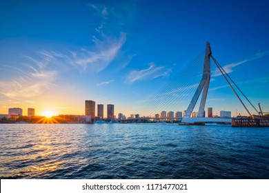 Erasmus Bridge (Erasmusbrug) and Rotterdam skyline on sunset over Nieuwe Maas river. Rotterdam, Netherlands