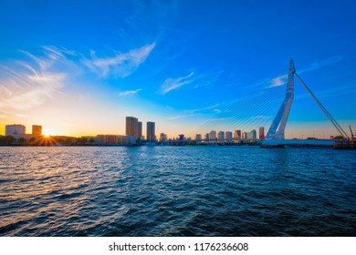 Erasmus Bridge (Erasmusbrug) and Rotterdam skyline on sunset over Nieuwe Maas river. Rotterdam, Netherlands