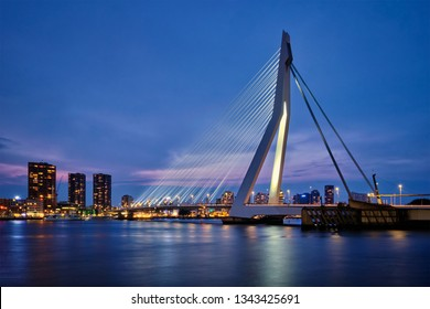 Erasmus Bridge (Erasmusbrug) and Rotterdam skyline illuminated at night. Rotterdam, Netherlands
