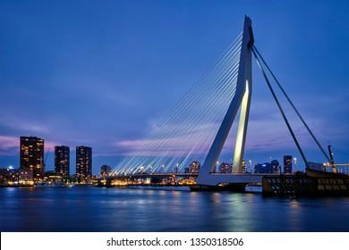 Erasmus Bridge (Erasmusbrug) and Rotterdam skyline illuminated at night. Rotterdam, Netherlands