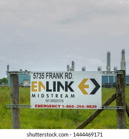 ERATH, L.A. / USA - JULY 3, 2019: A white Enlink Midstream sign bolted onto metal, and wooden structure sits in front of the company building on the side of the road in South Louisiana.