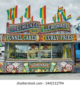 ERATH, L.A. / USA - JULY 4, 2019: A french fries, lemonade stand and nacho booth food cart at a street fair, located at a carnival for Fourth of July, Independence day festival in Erath, Louisiana.