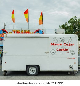 ERATH, L.A. / USA - JULY 4, 2019: Maws Cajun cookin LLC, a street food booth truck cart at a street fair, located at a carnival for Fourth of July, Independence day festival in Erath, Louisiana.