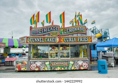 ERATH, L.A. / USA - JULY 4, 2019: A corn dog, lemonade stand and nacho booth food cart at a street fair, located at a carnival for Fourth of July, Independence day festival in Erath, Louisiana.