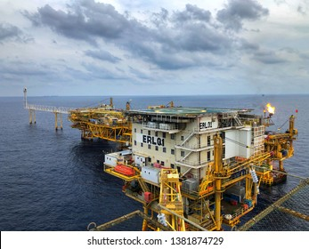 Erawan Gas field, Gulf of Thailand, Thailand : April 17, 2019 - Offshore rig platform or Offshore oil and gas Accommodation Platform or Living Quarter and Production plant with a calm sea and blue sky