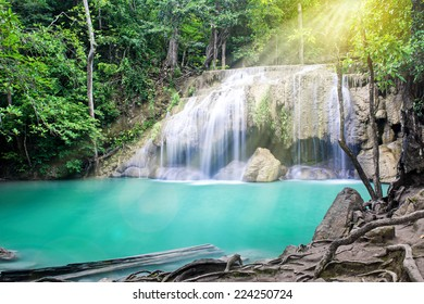 Erawan waterfall with sunshine in tropical forest, Thailand