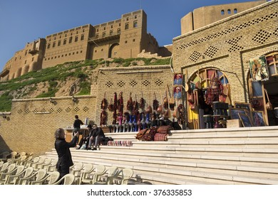 Erbil, Iraq - February 9, 2016: Old shops in Erbil city celing imported and handmade music instruments near the historial famous castle and foriegn touris shooting the shop