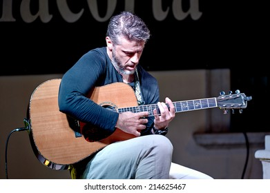 "ERBUSCO,ITALY - AUGUST 27:  exhibition live of the  italian guitar player Davide Sgorlon at the event ""Acoustic Franciacorta 2014"",27 August ,2014 in Erbusco,Italy"