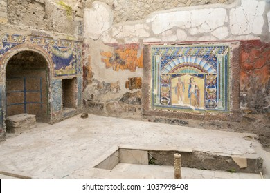 Ercolano, Italy- March 26, 2016: Mosaic and ruins inside the Herculaneum archeological site near Naples during a summer day.
