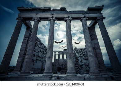 Erechtheion temple in full moon, Athens, Greece. Scary gloomy scene with bats for Halloween theme. Ancient Greek architecture of Athens at night. Old ruins on the top of Acropolis hill in moonlight.