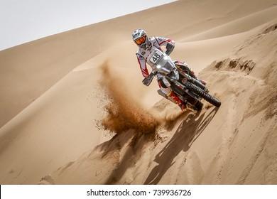 Erfoud, Morocco. October 9, 2017. Oilibya Cross-Country Rally of Morocco, preparation to Dakar 2018. CS Santosh, Hero, in the dunes.
