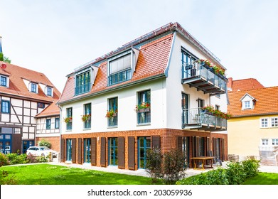 ERFURT, GERMANY - JUN 16, 2014: Beautiful nature and houses of the touristic part of the city of Erfurt, Germany. Erfurt is the Capital of Thuringia and the city was first mentioned in 742