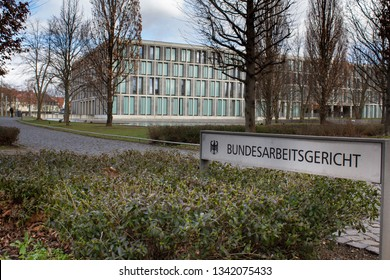 "Erfurt, Germany - Mar. 18, 2019: Sign saying ""Bundesarbeitsgericht"" wich means ""Federal Labor Court"" , highest labor court in Germany. Court building in background."
