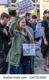 """Erfurt, Germany – Mar. 23, 2019: I am not a bot sign slogan at protest march demonstration demo rally against new copyright law by European union, namely """"Artikel 13"""". Protester got called bots by CDU"""