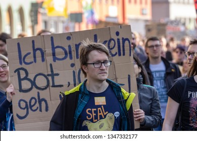Erfurt, Germany – Mar. 23, 2019: I am not a bot sign slogan and man at protest march demonstration against new copyright law by European union after german CDU told online petition was signed by bots