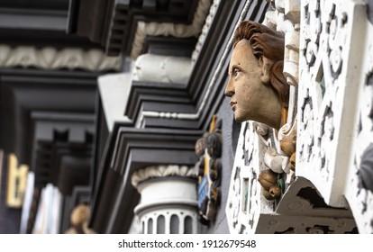 Erfurt, Thuringia, Germany - 31 August 2020: Ornate sculpture on home on street in Erfurt, Germany
