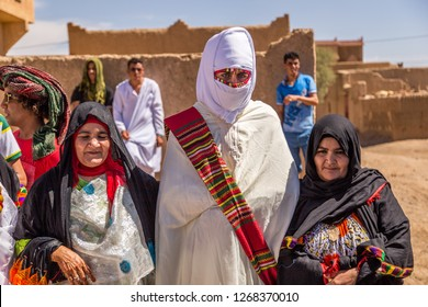 Erg Chebbi, Sahara Desert, Morroco - September 25, 2014: Unidentified Berber people in wedding ceremony with their traditional dress, women dance with their authentic music.