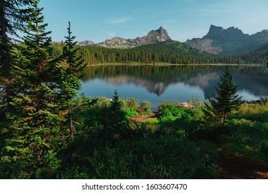 Ergaki National Park, Lake Svetloye. Reflection of mountains in the water. Siberia, taiga forest.  - Shutterstock ID 1603607470