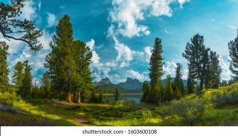 Ergaki National Park. Panorama of Svetloe Lake with mountain views on a hot summer day. Green grass. - Shutterstock ID 1603600108