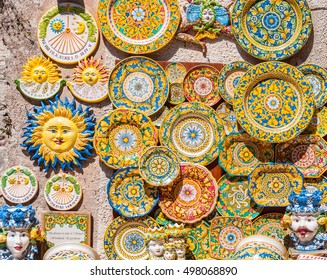 ERICE, ITALY - SEPTEMBER 12, 2015: Traditional souvenirs of ceramics and Trinacria is symbol of Sicily, Italy.