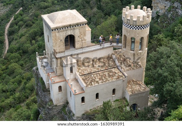 ERICE, SICILY, ITALY - SEPTEMBER 24, 2019: Tourists are visiting the recently restored Pepoli Turret (Toretta Pepoli) built on a cliff-side, with a panoramic view, in the town of Erice, Sicily, Italy.