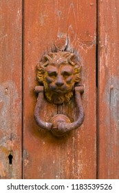 Erice, Trapani - Sicily, Italy: Erice is an ancient medieval village near Trapani whose foundation dates back to the Phoenicians. Knocker of a red tinted doorway in the shape of a lion.
