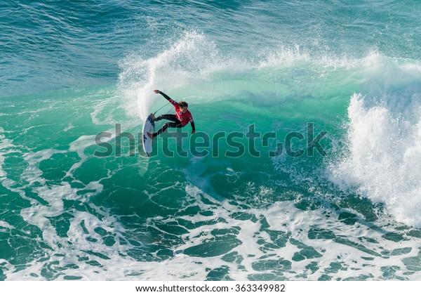 ERICEIRA, PORTUGAL - JANUARY 12, 2015: Noah Shweizer (USA) during the 2016 World Junior Championships, Men's Junior Tour #1 at Ribeira D'Ilhas beach - Ericeira, Portugal.