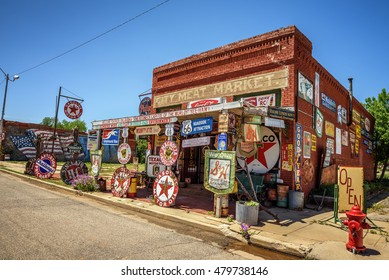 ERICK, OKLAHOMA, USA - MAY 12, 2016 : Sandhills Curiosity Shop located in Erick's oldest building - the City Meat Market. It is a large collection of crazy Route 66 memorabilia.
