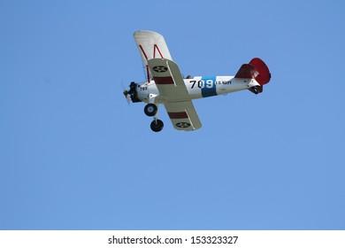 Erie, Pennsylvania, USA - September 5, 2013: A US Navy Stearman bi-plane flying at the 2013 Tall Ships Erie Festival