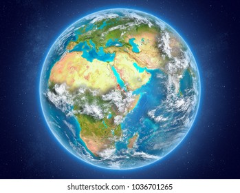 Eritrea in red on model of planet Earth with clouds and atmosphere in space. 3D illustration. Elements of this image furnished by NASA.