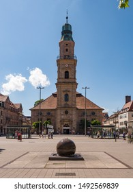 Erlangen, Germany, August 18, 2019: Wide Shot of the Church of Huguenots with Fountain in Foreground Erlangen Bavaria Germany