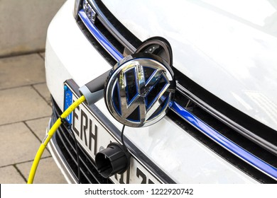 Erlangen, Germany SEP15,2018 :EV Car or Electric car at charging station with the power cable supply plugged in on blurred nature with soft light background. Eco-friendly alternative energy concept
