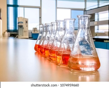 The Erlenmeyer flask in the line with color range solvent using for analysis calibration curve of iron in waste water sample. The experiment in chemistry laboratory.