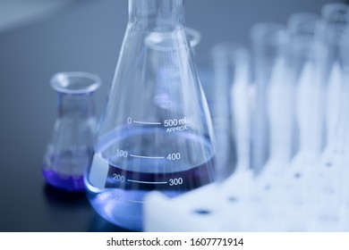 Erlenmeyer flasks containing blue liquid