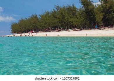 Ermitage-Les-Bains, Overseas region of France, Reunion - Jan 21, 2016: Sea water and sandy beach