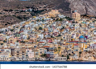 Ermoupoli town, capital of Syros island. At the back there is Ano Syra. Both town's cathedrals can be seen, the catholic one at the left hill's top, the orthodox one at the right.
